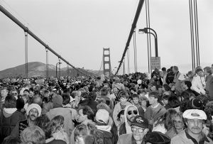 Image of Michael Jang's photograph called Golden Gate Bridge 1987 of a large group of people on the Golden Gate Bridge.