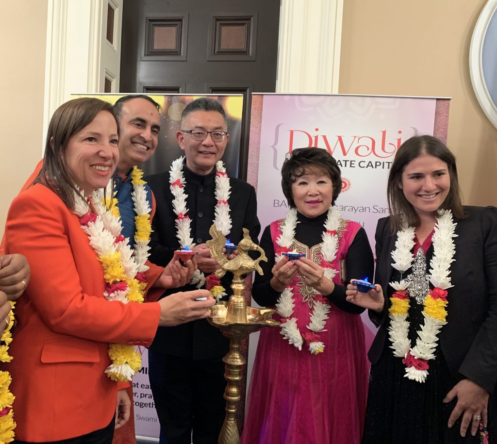 Image of the Lieutenant Governor and others celebrating the Diwali Holiday at the State Capitol